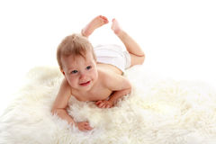 Baby on a soft rug Stock Image