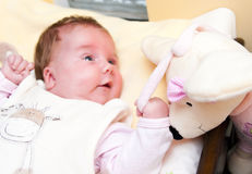 Baby with soft toy. Happy baby with her soft toy royalty free stock image