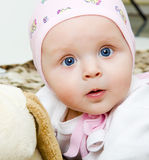 Baby with a soft toy. Blue-eyed baby with a soft toy. portrait Royalty Free Stock Photos