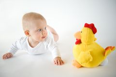 Baby with soft toy. Baby girl on white background with toy Stock Photography
