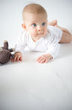 Baby with soft toy. Baby girl on white background Royalty Free Stock Photography