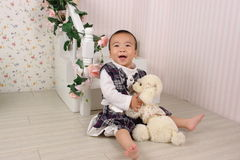 Baby and soft toy dog. Baby is very happy with the soft toy dog Royalty Free Stock Images