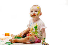 Baby soiled by paint lodges Stock Photos
