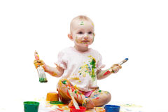 Baby soiled by paints Stock Photo