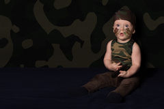 Baby soldier in uniform with war paint on his face. Boy in unifo Royalty Free Stock Photography