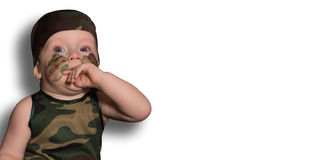 Baby soldier in uniform with war paint on his face. Boy in unifo Stock Image