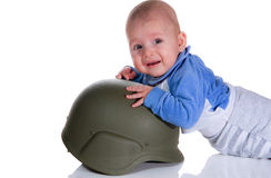 Baby in a soldiers helmet Royalty Free Stock Photos