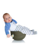 Baby in a soldiers helmet Stock Image