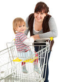 Baby son in trolley with mother taking shopping Royalty Free Stock Image