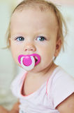Baby with soother. Portrait of baby girl with soother Royalty Free Stock Photography