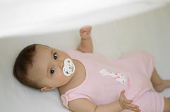 Baby with soother. Baby girl with white soother Stock Photos