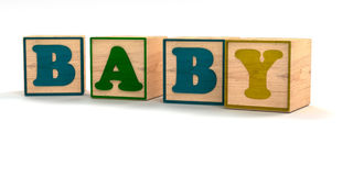 Baby Spelled out In Child Color Blocks. Angled with White Background and soft shadows Royalty Free Stock Photography