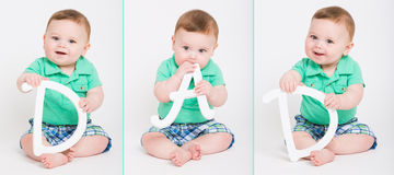 Baby Spells DAD with Letters. Three separate images of an 8 month year old baby sitting on a white background holding the letters to spell dad.dressed in a cute Stock Photo