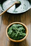 Baby spinach as a side dish in a wooden bowl. stock photo