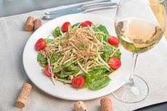 Baby spinach salad with quinoa served in a white plate stock images