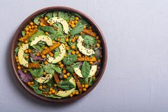 Baby spinach salad with sweet potato , chickpeas and avocado . Vegan healthy food stock photos
