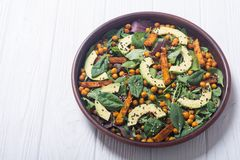 Baby spinach salad with sweet potato , chickpeas and avocado . Vegan healthy food royalty free stock photos