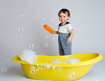 Baby with sponge Stock Image