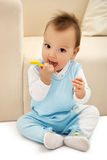 Baby with spoon Stock Photo