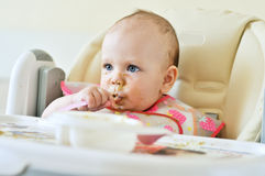Baby with spoon Stock Photography