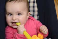 Baby with spoon Royalty Free Stock Photos