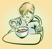 The baby with a spoon in hand eats. Royalty Free Stock Photos