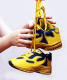 Baby sport shoes pair, yellow color. On white background Stock Photos