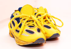 Baby sport shoes pair, yellow color. On white background Royalty Free Stock Images