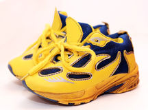 Baby sport shoes pair, yellow color. On white background Stock Image