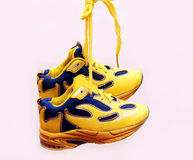 Baby sport shoes pair, yellow color. Baby sport shoes pair, yelow color Stock Photography