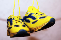 Baby sport shoes pair, yellow color. Baby sport shoes pair, yelow color Royalty Free Stock Images