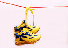 Baby sport shoes pair, yellow color. Baby sport shoes pair, yelow color Royalty Free Stock Photography