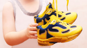 Baby sport shoes pair, yellow color. Baby sport shoes pair, yelow color Royalty Free Stock Image