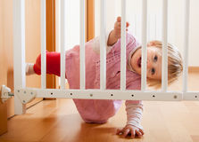 Baby and  stair gate Royalty Free Stock Images