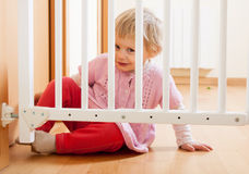 Baby and  stair gate Stock Photos