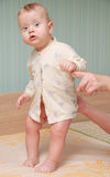 Baby standing on a cot Royalty Free Stock Images