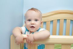 Baby Standing in Crib Royalty Free Stock Images