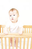 Baby In Standing In Crib Royalty Free Stock Photos