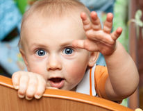 Baby standing in crib Stock Image