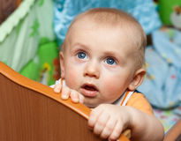 Baby standing in crib Royalty Free Stock Photography