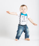 Baby Standing in Funny Surfing Posistion Royalty Free Stock Photos