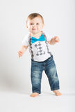 Baby Standing with Hands Out Smiling Stock Photos