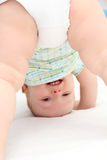 Baby standing on head Royalty Free Stock Photos