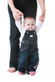 Baby standing with Help of Mom Stock Photos