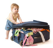 Baby standing near suitcase Royalty Free Stock Photos
