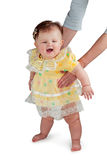 Baby standing with support for mothers Royalty Free Stock Images