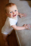 Baby Standing Up Stock Photo