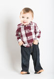 Baby Stands in Flannel and Jeans Pulling Up Pants Royalty Free Stock Photo