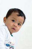 A baby staring to camera. Royalty Free Stock Images