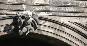 Baby statue  venice. A cherub over an arch of a doorway Royalty Free Stock Photography